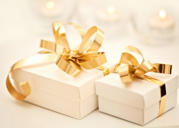 gift boxes with golden ribbon bow; Shutterstock ID 90407911; PO: aol; Job: production; Client: drone